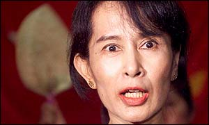 Aung San Suu Kyi answers a question during a news conference, 6 May 2002