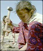 A child using a hammer