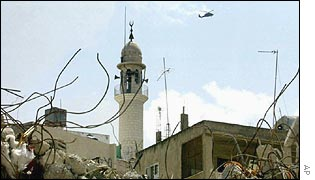 Israeli helicopter flies above the mosque at the devastated Jenin refugee camp