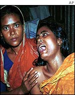 Zulekha Begum, right, wails for her dead daughter