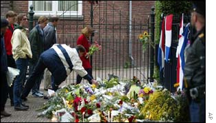 People gather to bring flowers and burn candles near Pim Fortuyn's house in Rotterdam