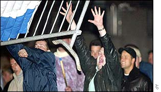 Protesters throw a barrier at police during protests outside the Hague