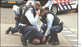 Police arrest an unidentified suspect outside the Media Center in Hilversum