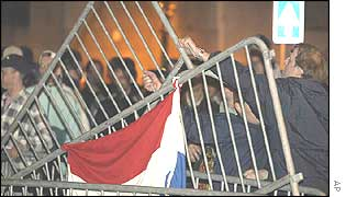 Demonstrators hurl barriers outside the parliament building in the Hague