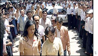 Aung San Suu Kyi, front right, as she arrives at party headquarters