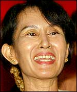 Aung San Suu Kyi smiles after her release