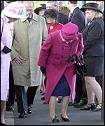 The Queen examines her shoe during a walkabout