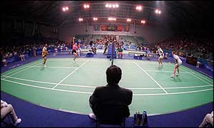 An umpire overlooks a badminton match at the Sydney Olympics
