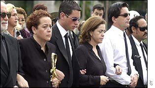 Surviving members of Banzer's family leading mourners