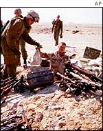 US soldiers with a hidden cache of Iraqi weapons during the Gulf War