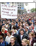 Marchers in Rotterdam walk silently in remembrance of Fortuyn