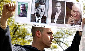 Man holds placard showing Fortuyn alongside pictures of Martin Luther King, Malcolm X and John F Kennedy