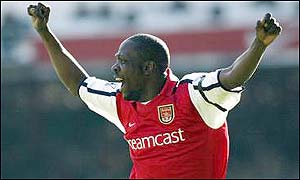 Arsenal's Lauren celebrates after his penalty gives the Gunners a 2-1 win against Spurs