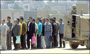 Palestinians waiting at a checkpoint in southern Gaza