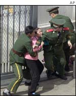 North Korean refugee being detained outside the consulate