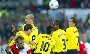Feyenoord's Paul Bosvelt, left, backs into the Borussia Dortmund wall