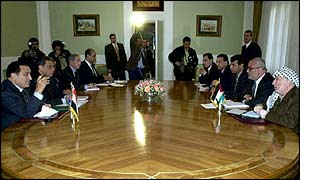 Hosni Mubarak at a meeting with Yasser Arafat