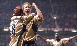 Freddie Ljungberg, Ray Parlour and Sylvain Wiltord celebrate for Arsenal