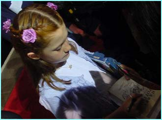 Bonnie Wright (Ginny Weasley) signs one of many autographs