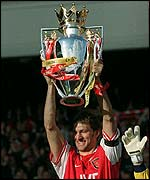 Arsenal's Tony Adams holds aloft the Premiership trophy in 1998