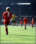 Arsenal's Charlie George scores the winning goal in the 1971 FA Cup Final