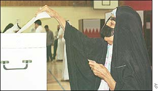A veiled Bahraini woman casts her vote