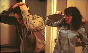 Little Mo hits Trevor with an iron in EastEnders