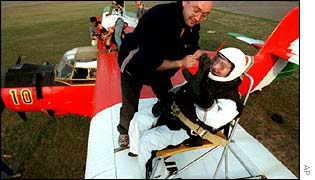 Erzsebet Keri, 73, being strapped to the wing of a plane