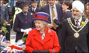 The Queen greets the crowds along with local dignitaries
