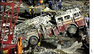 A fire engine is pulled out of the ruins of the World Trade Centre