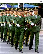 Chinese military police officers march near the US and Japanese embassies in Beijing