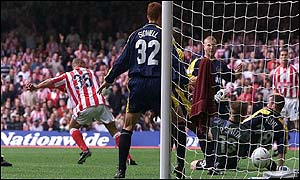 Stoke striker Deon Burton puts his side into the lead with a poacher's goal