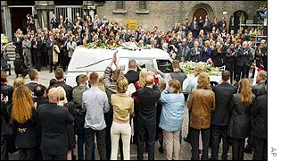 Friends and family surround the hearse as it leaves the Laurentius and Elisabeth Cathedral in Rotterdam