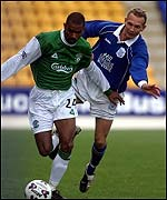 Frederic Daquin shows Tommy Lovenkrands a clean pair of heels