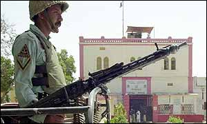 Pakistani paramilitary stands guard in front of Hyderabad central prison