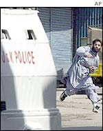 Demonstrator stoning a police van in Sri Nagar
