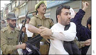 Separatist leader Javid Ahmad Mir being arrested after a rally protesting the arrest of another leader