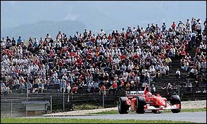 Michael Schumacher is watched by the crowds in Austria