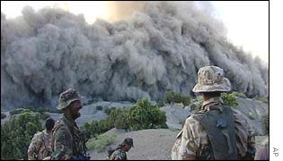 British soldiers look on as ordnance is destroyed near one of the caves in Paktia Province