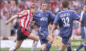 James Beattie is outnumbered by Newcastle defenders