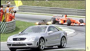 The safety car leads Barrichello after a crash on lap 27
