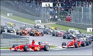 Rubens Barrichello leads out of the first corner in his Ferrari on lap one