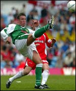 Yeovil's Carl Alford battles with Stevenage's Stuart Fraser