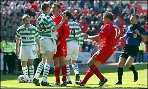 Aberdeen's Jamie McAllister and Celtic's Colin Healy