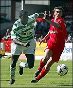 Momo Sylla tries to escape Derek Young