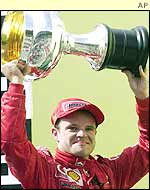 Rubens Barrichello holds the winner's trophy