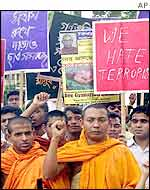 Buddhist demonstrators protest against the murder of a senior monk