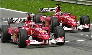 Rubens Barrichello slows down to allow Michael Schumacher through