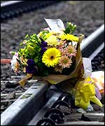 Flowers at the scene of the Hatfield crash in which four people lost their lives