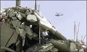 Yasser Arafat's helicopter flies over rubble in Jenin camp